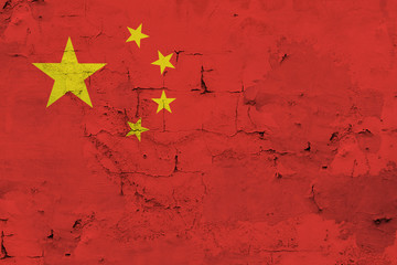 Chinese flag on the old wall background