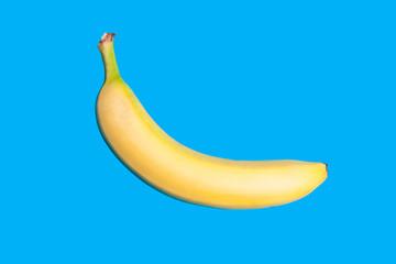 Yellow fresh banana on vivid blue background. Minimal style. Top view