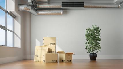 Umzugskartons im leeren Raum beim Umzug