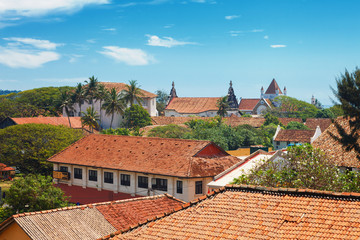 Beautiful scenery of ancient Dutch Galle Fort with Christian church and Buddhist stupa - view from fortification wall, southwest coast of Sri Lanka island, South Asia