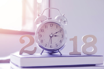 2018 Happy New Year with clock , book on wood isolated white background,Vintage tone,Copy space for your text.