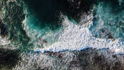 Drone view of waves hitting the shore