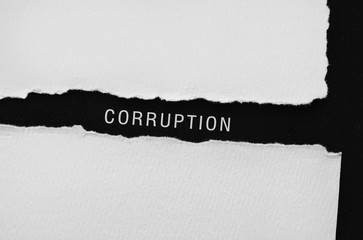 Corruption written on torn paper