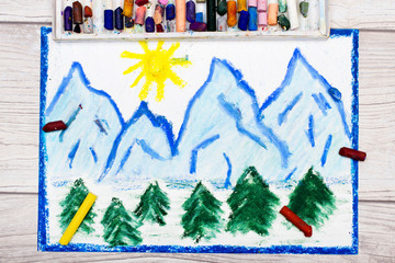 Photo of colorful drawing: landscape of snow-capped mountain peaks