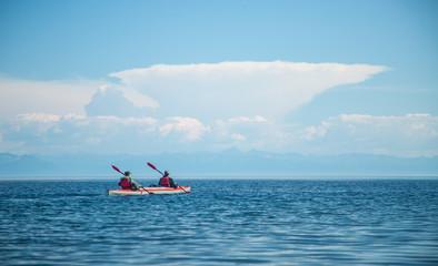 Mеn kayaking on Lake Baikal. Landscape. Siberia.