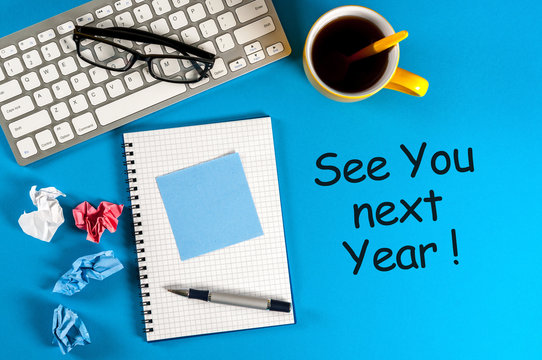See you next year - memo at blue office table. 2018 new year coming