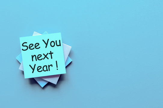 See you next year written on a note pile at the office, mockup. Empty text for text