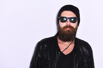 Rock fan or gangster in sunglasses. Guy with beard