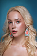 Beautiful blonde woman with long, healthy, curly and shiny hair. Hairstyle loose