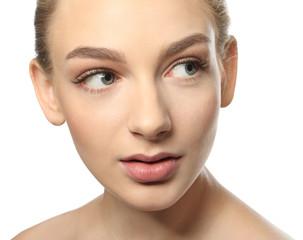 Beautiful woman with long eyelashes on white background, closeup