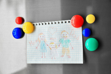 Family drawing on refrigerator door