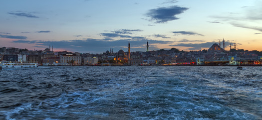 Panorama of Cityscape of Golden horn with ancient street and modern buildings in summer Istanbul is a transcontinental city in Eurasia, straddling the Bosphorus strait
