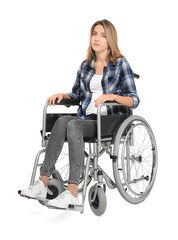 Young woman in wheelchair on white background