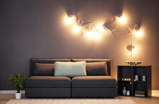 Elegant living room interior with grey sofa