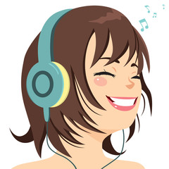 Beautiful young girl happy smiling with eyes closed listening music using big headphones