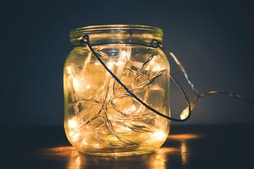 Glass jar with yellow lights