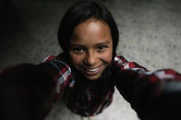 Self portrait of beautiful girl in shanty town.