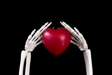 red heart holds in hands a skeleton on a black background. Life and death.