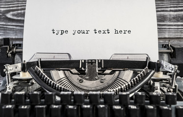 type your text here. Old type writer with a blank sheet of paper. vintage typewriter