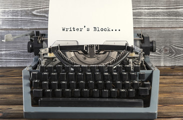 Writers Block typed words on a Vintage Typewriter. old. Close up.