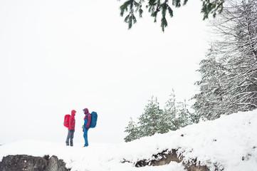 Tourist couple on the top of mountain