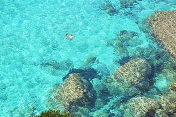 People swimming in the emerald waters of Cala Mitjana, Menorca, Balearic Islands, Spain, Mediterranean, Europe