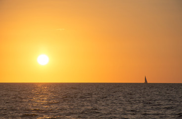 Florida Sunset horizon with a sailing boat