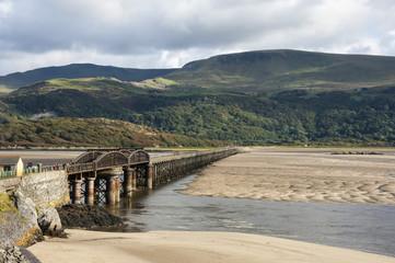 Barmouth Bridge (Viaduct), largely wooden construction, on Cambrian Coast Railway across River Mawddach, Cardigan Bay, Gwynedd, Wales, United Kingdom, Europe