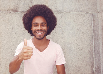 African american hipster man showing thumb up