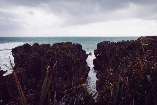 Ocean between rocks in New Zealand