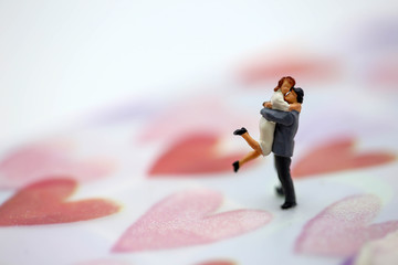 Miniature people : Couple Lover standing on heart background. lovely concept.