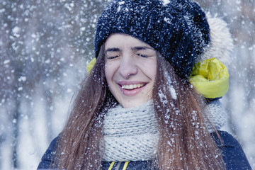 Young beautiful woman having fun with snow. Fine winter day. (Christmas, new year, celebration concept)