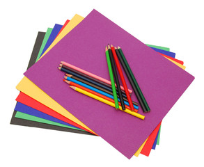 A stack of colored file folders and pencils . Isolated with a clipping path included.
