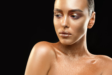 Nude brunette with gold skin artisitc shot