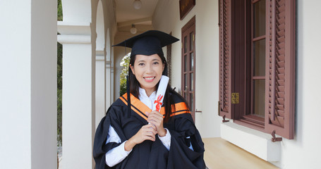 Excited woman get graduation and hold certificate