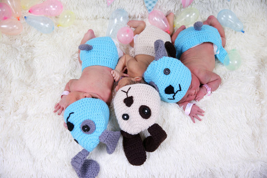 Newborn babies wearing dog costumes to celebrate the New Year of the Dog are pictured at the nursery room of Paolo Chokchai 4 Hospital in Bangkok