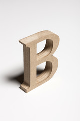 wood alphabet isolated the white background.