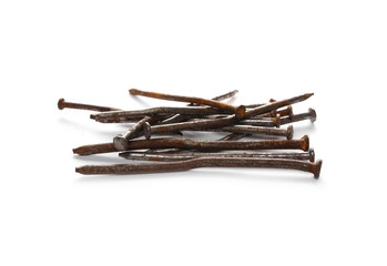 Pile of old, rusty metal nails isolated on white background