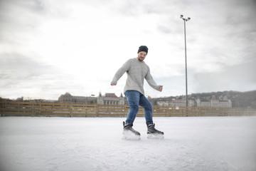 Guy having fun ice skating