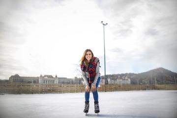 Girl having fun ice skating
