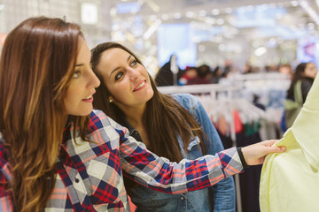 Young friends shopping together in a store