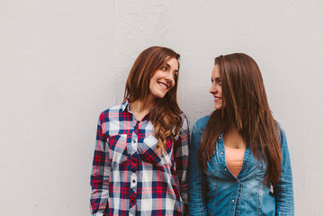 Two Young Girls Smiling Each Other