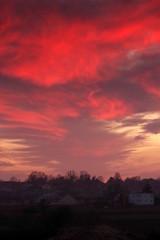 In de dag Rood traf. czerwony zachód słońca