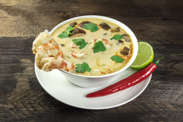 Tom Yam, traditional Thai soup with shrimps and mushrooms, with chilli pepper and lime