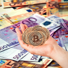 Golden Bitcoins. Bitcoin in the hands. Photo (new virtual money ) New crypto currency in the form of the coins.