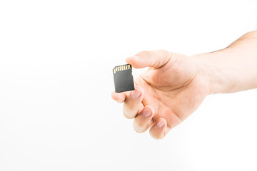 Hand Holding Memory Card On White Background