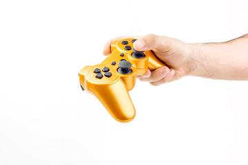 Hand Holding Orange Gaming Joystick Controller On White Background Closeup
