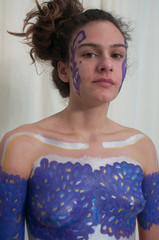 Body painting project, young woman colored on breast and face