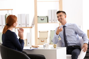 Female psychologist with client in office
