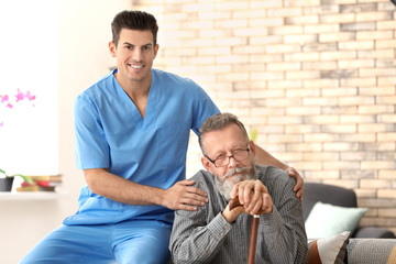 Caregiver with senior man at home
